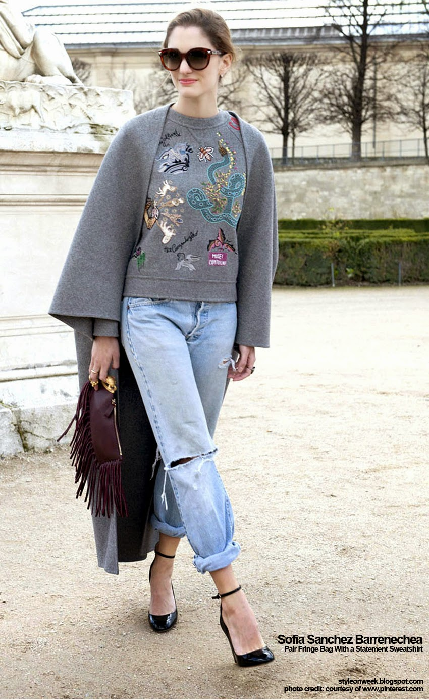 Street Style Inspiration - Sofia Sanchez Barrenechea Pair Fringe Bag With a Statement Sweatshirt