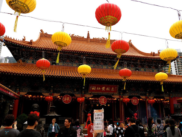 Exterior of Sik Sik Yuen Wong Tai Sin Temple, with Chinese lanterns above the courtyard | Hong Kong