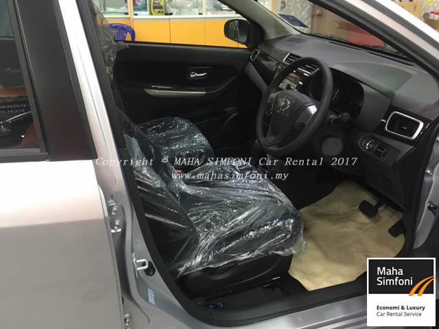 Perodua bezza 1.3 auto silver dalam dan dashboard