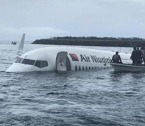 Photos: Plane Overshoots Runway With Passengers, Crash-lands In The Ocean