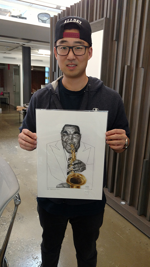 Art print with the caricature of jazz musician Charlie Parker portrayed by artist David Pugliese in the hands of a happy customer