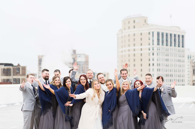 bridal party on z belt lot rooftop cheering