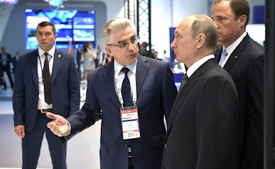 Vladimir Putin with Andrei Tyulin, Director General of Russian Space Systems, at the International Aviation and Space Salon MAKS-2017.