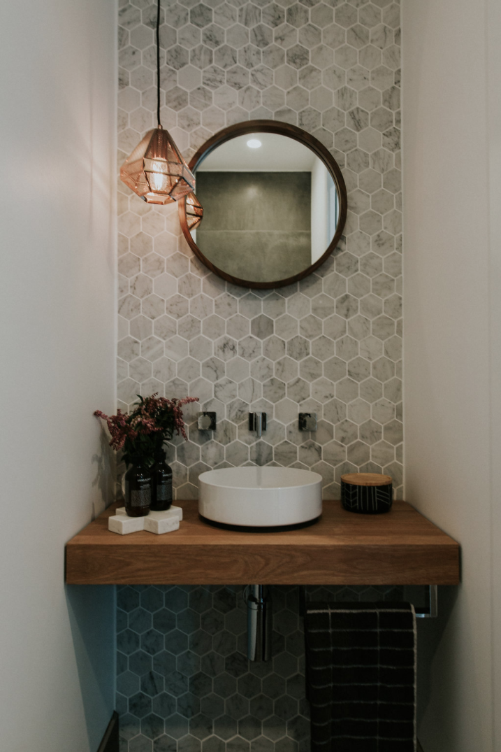 Bathroom with Marble Hexagon Tile Accent Wall
