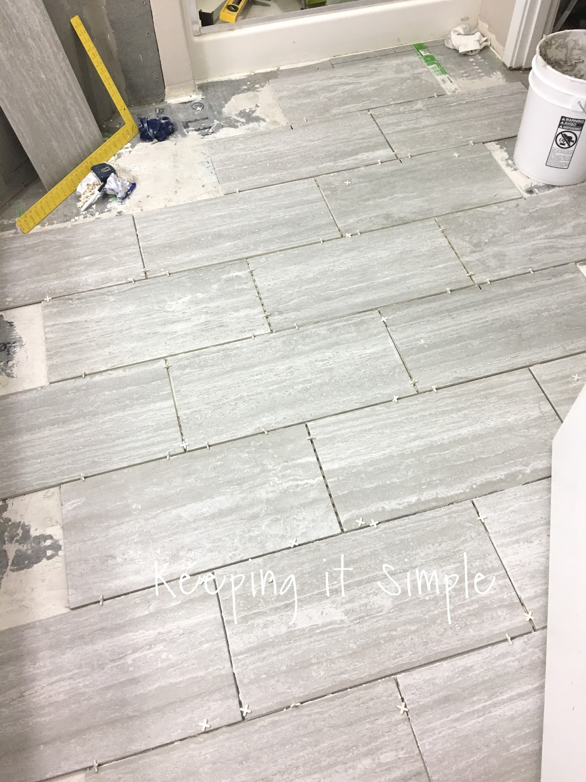 Tips on how to install tile flooring in a bathroom with ridgemont then using the tile saw he started adding the tiles that needed to be cut we did the toilet room later because we did the backer board a different time dailygadgetfo Image collections