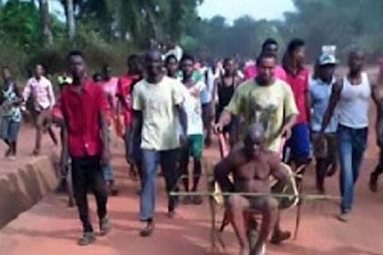 Tertangkap Basah, Dukun Dipukul dan Diarak Keliling Desa