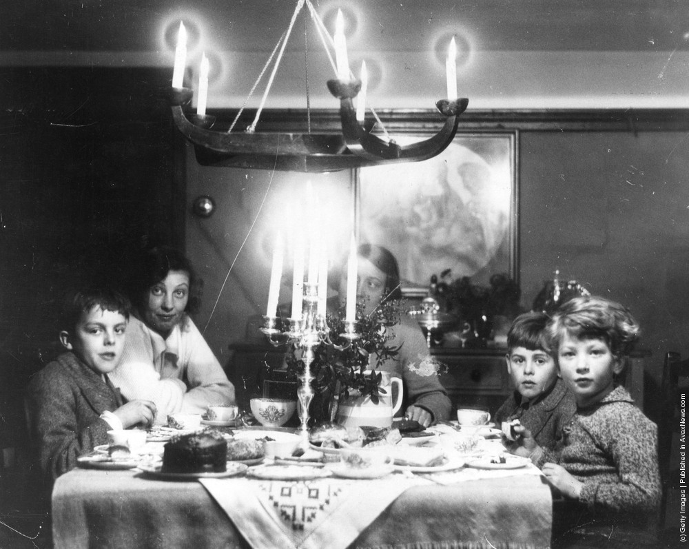 A Family At Christmas Tea Time With Chocolate Cake Candelabra And Holly On The Table Circa 1935 Photo By General Photographic Agency Getty Images