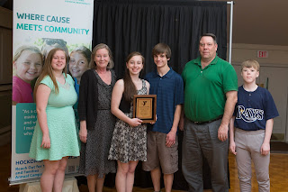 Tara Lambert receives Youth of the Year Award alongside her family