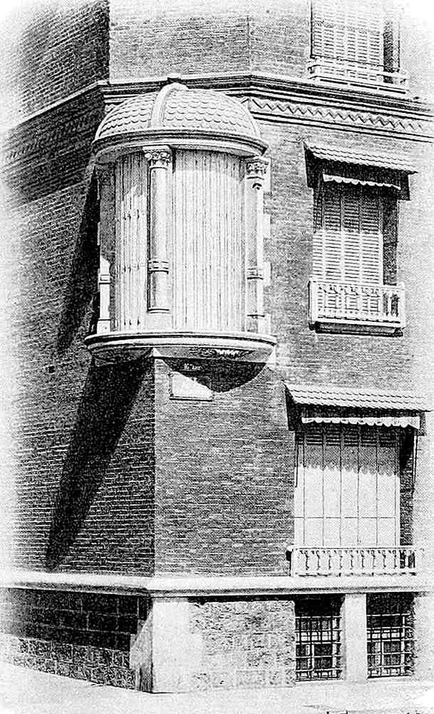 an 1890s curved glass corner window, a photograph