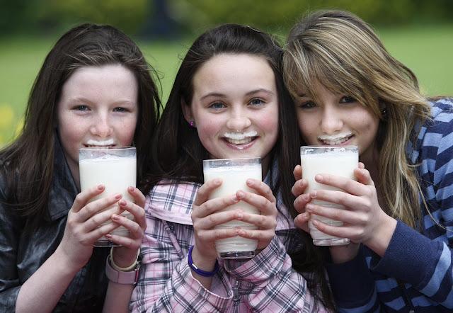Sisters drinking milk