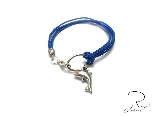 Pulsera en algodón azul con delfín