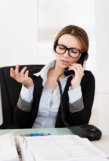Disengaged businesswoman speaking on phone