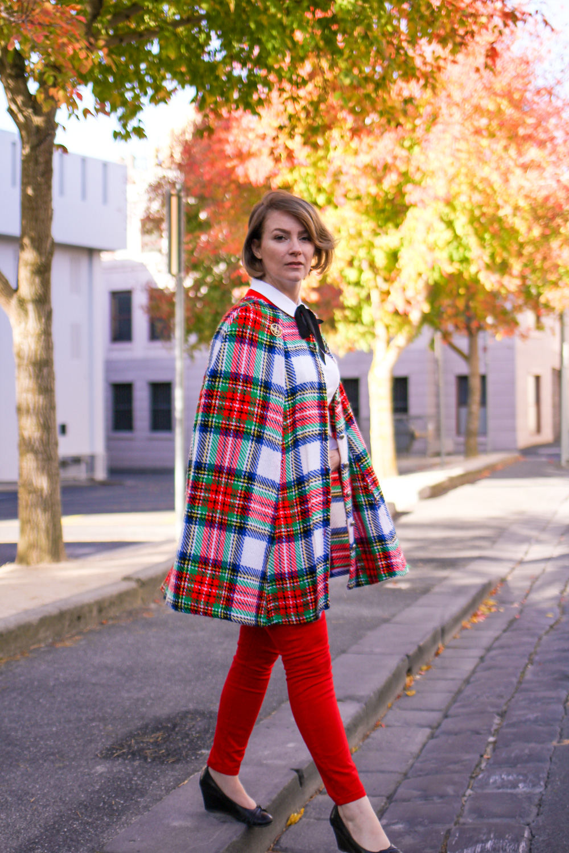@findingfemme wears tartan cape and red jeans in Ballarat autumn.