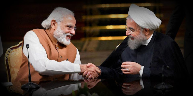 Image Attribute: File photo of Indian Prime Minister Narendra Modi with Iranian President Hassan Rouhani / Source: Press Trust of India