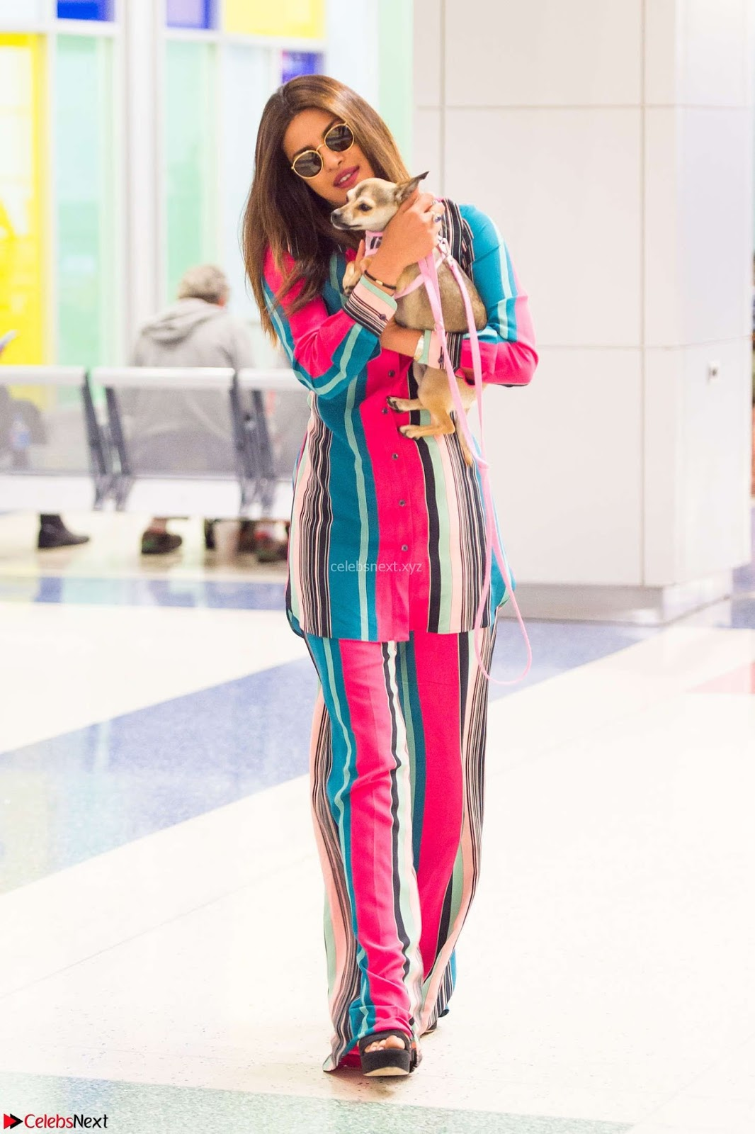 Priyanka Chopra in Colorful Jumpsuit arriving at JFK Airport New York 18 June 2017 ~ CelebsNext Exclusive