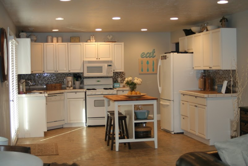 {Love Stitched}: How To Refinish Your Kitchen Cabinets And