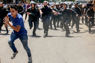 Egyptian student running from security forces