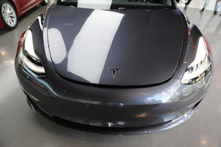 A Tesla Model 3 is seen in a showroom in Los Angeles, California U.S. January (Credit: KWSN.com) Click to Enlarge.
