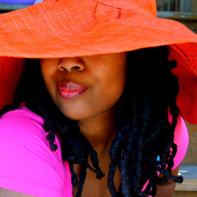 orange sunhat made in Kenya bought at a festival