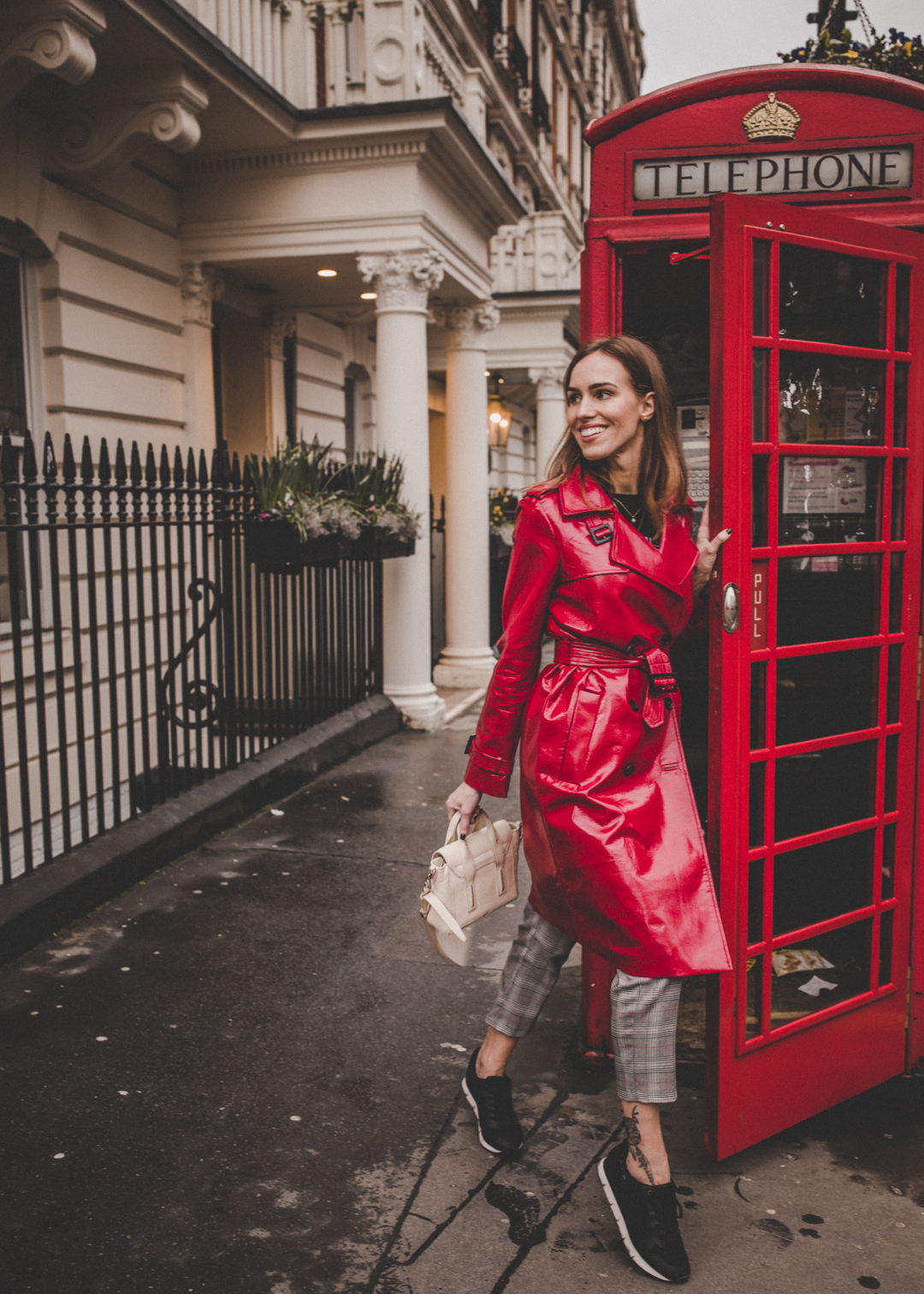 london telephone booth photo red vinyl trench coat