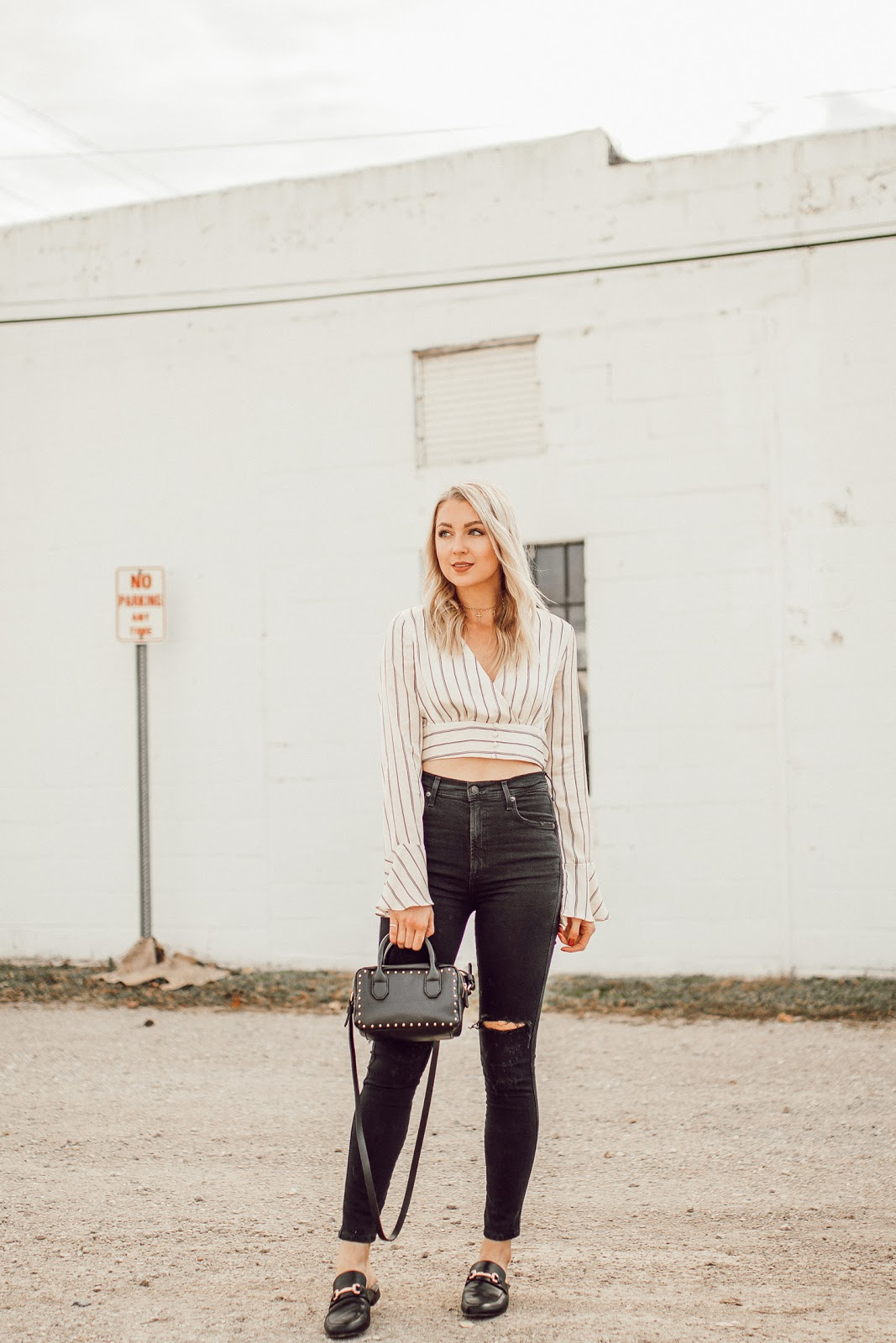 striped top with high-waisted black jeans