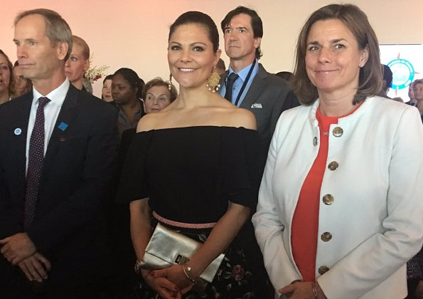 "Crown Princess Victoria and Prince Albert of Monaco attended the ""Ocean Conference. Princess Victoria wore  floral printed skirt. carried Anya Hindmarch Gold Metallic Clutch"