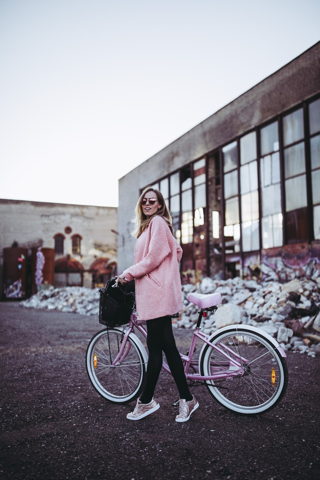 pink coat sneakers bike fall style