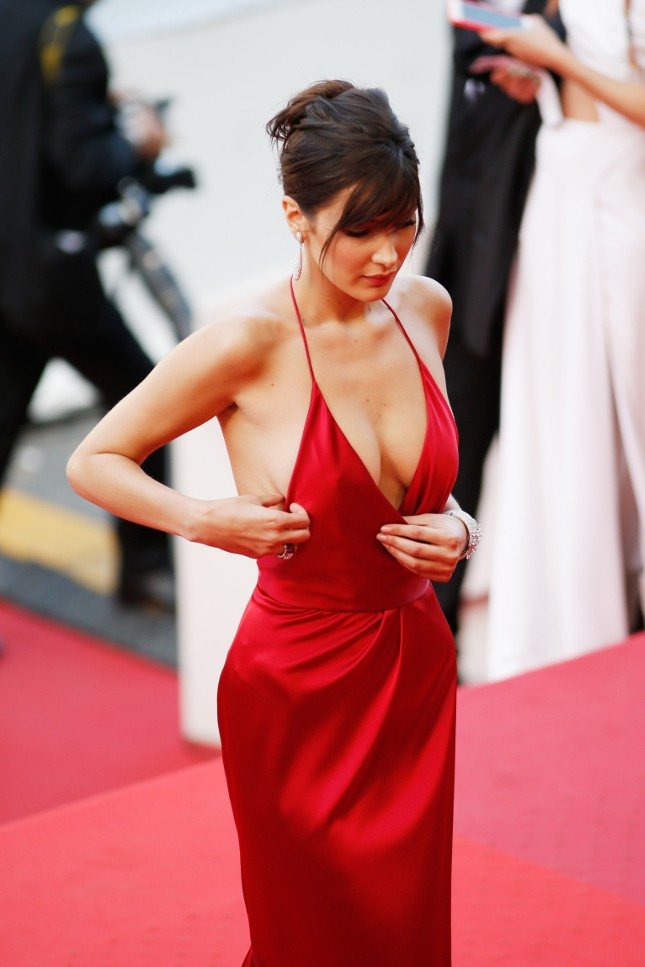 Bella Hadid's sexy dress that barely hold her while on the red carpet at the 69th Cannes International Film Festival in France.