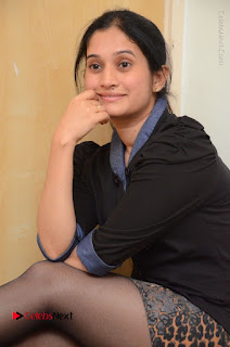 Telugu Actress Priyanka Pallavi Stills in Micro Mini Skirt at Nenosthaa Movie Song Launch at Radio City  0042.JPG