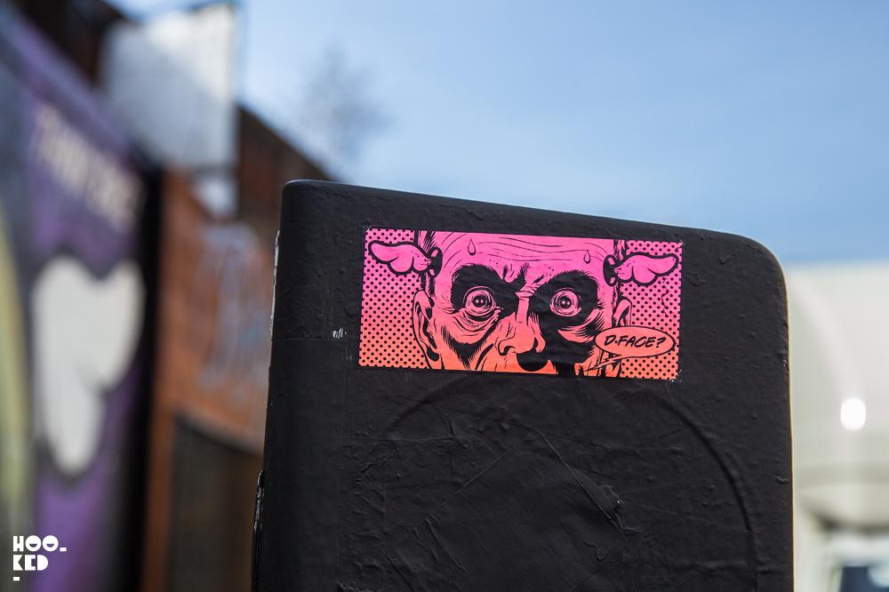 Shoreditch street art sticker by British artist D*Face