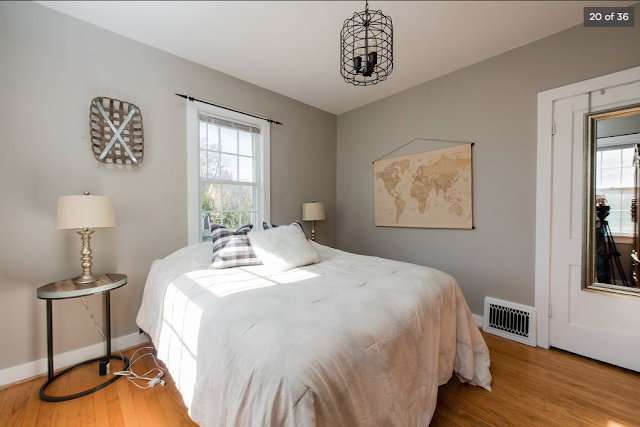 pale grey bedroom with double bed of Sears Mitchell •  4616 Arlington Avenue, Fort Wayne, Indiana