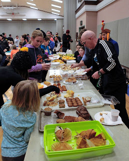 Franklin Turkey Trot participants enjoy complimentary breakfast treats after the race. Photo courtesy of Gloria Meredith Photography