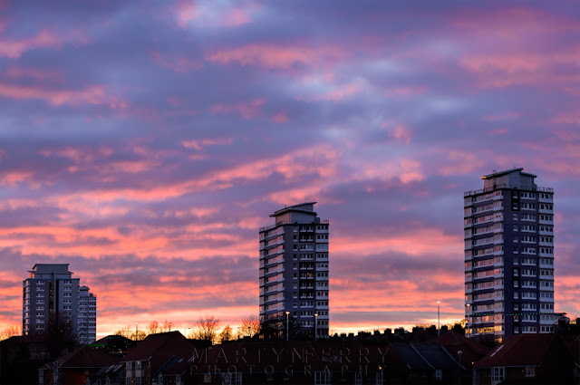 Sunset colours drift over high rise buildings in Sunderland on the north east coast
