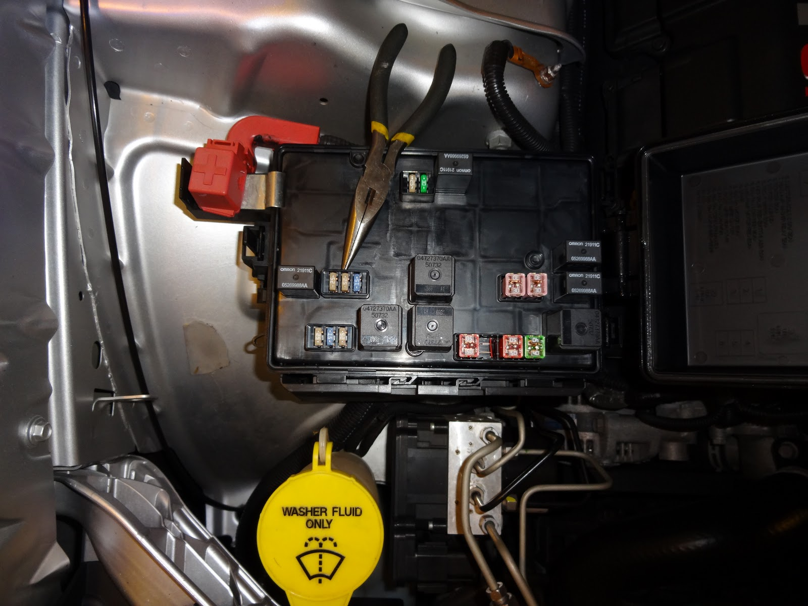 small resolution of this is looking into that fuse box the point of the needle nose is pointing at fuse 2 on the inside cover of the box there is also a diagram of what
