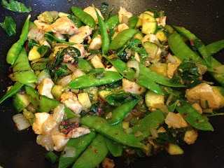 Asian chicken stir fry with swiss chard, snow peas, chili garlic sauce