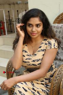 Telugu Actress Karunya Chowdary Stills in Short Dress at ATM Not Working Press Meet  0157.jpg