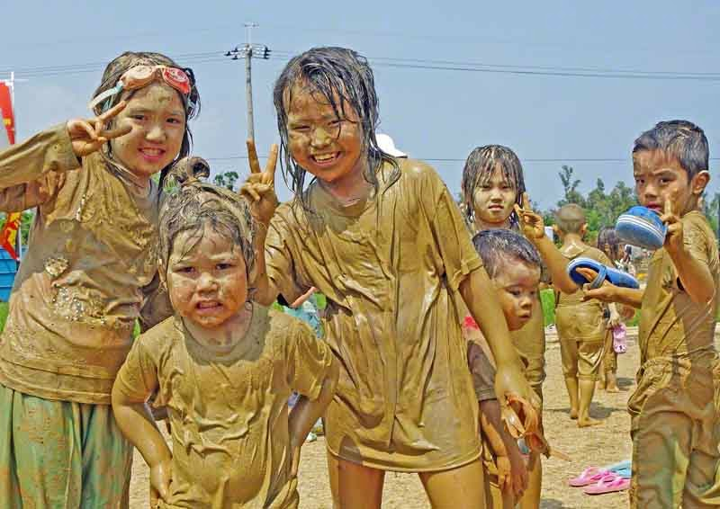 festivals,mud,children,springtime,Okinawa, Japan