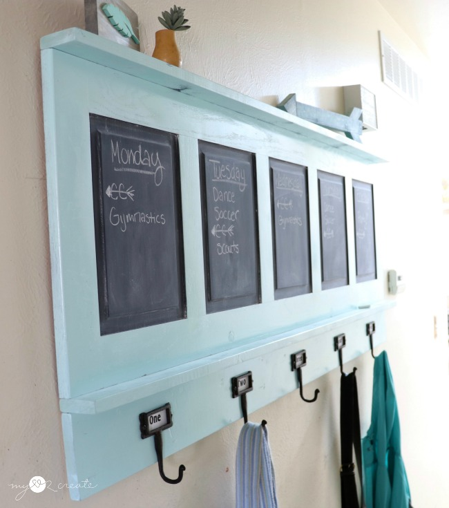 using a repurposed chalkboard coat rack as a backpack holder and command center