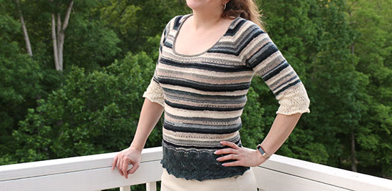Front view of Elphaba Pullover knit in stripes of scrap sock yarn.