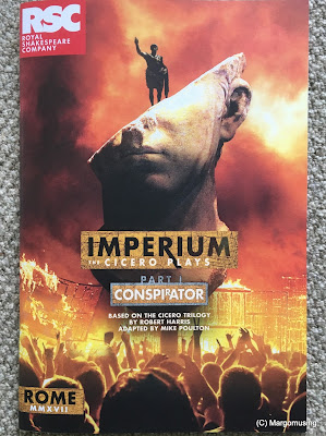 photo of programme with cover art showing a broken bust and against a backdrop of flames and rioters