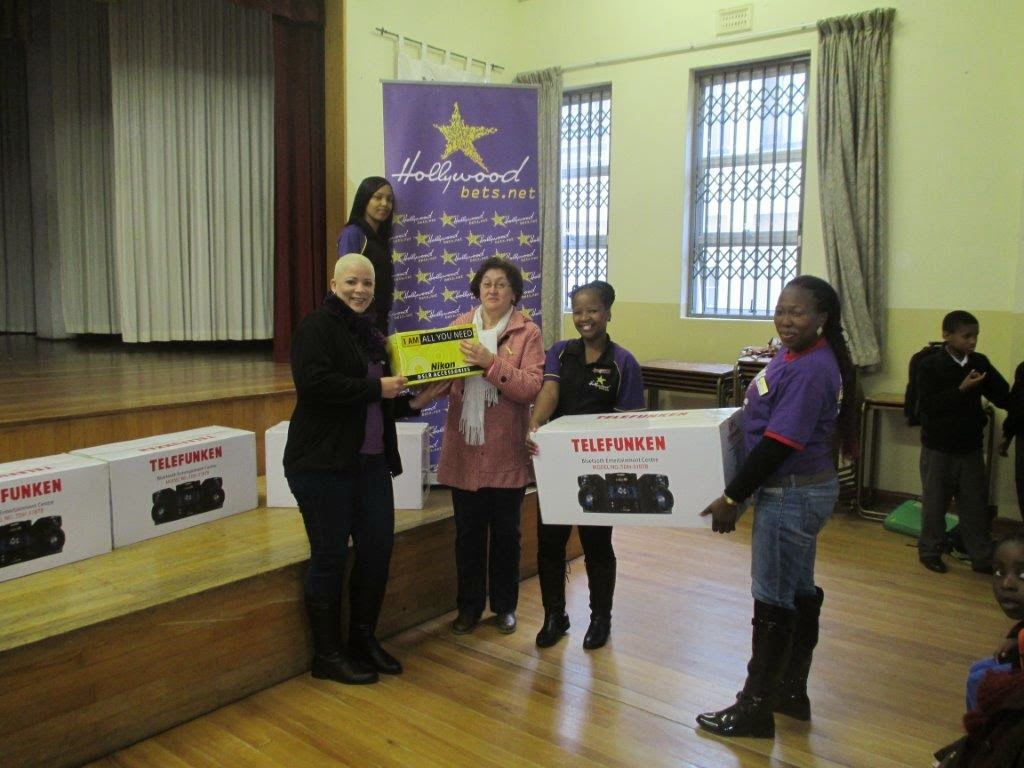 Hollywoodbets team handing over donations to the Dominican School for the Deaf in Wynberg