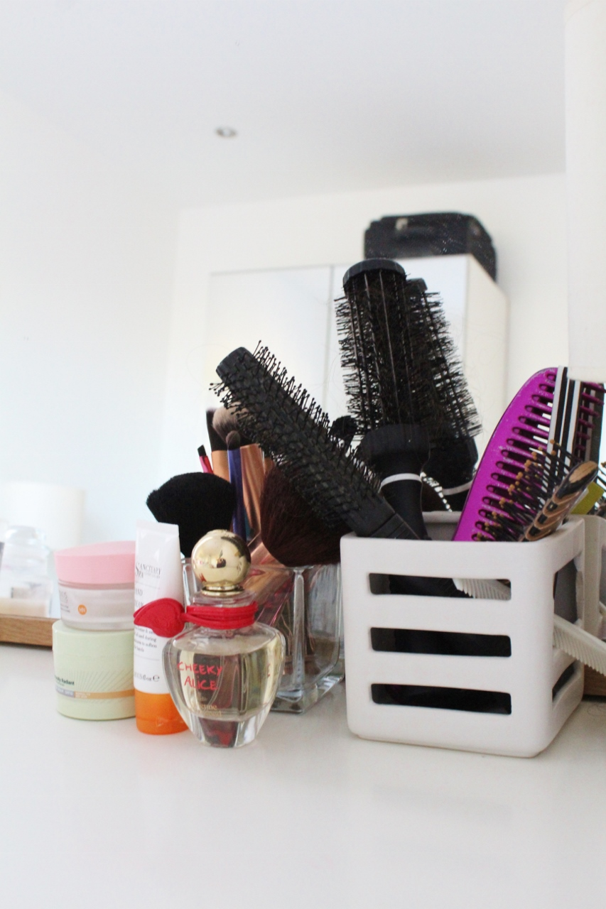 Brushes and make up on white dressing table