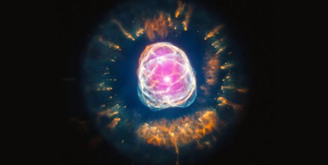 Composite image of planetary nebula NGC 2392. Image Credit: X-ray: NASA/CXC/IAA-CSIC/N. Ruiz et al; Optical: NASA/STScI