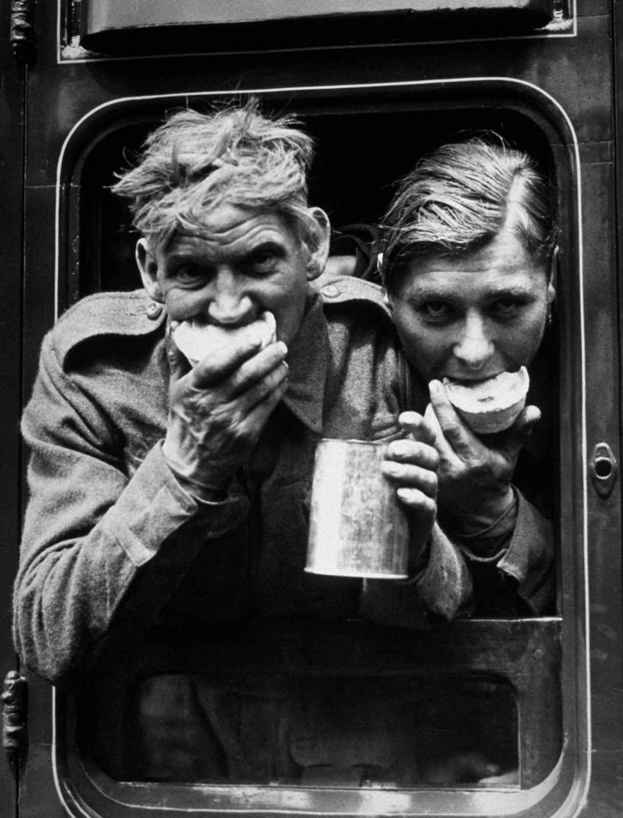 Allied soldiers enjoy food and drink upon returning to Britain.