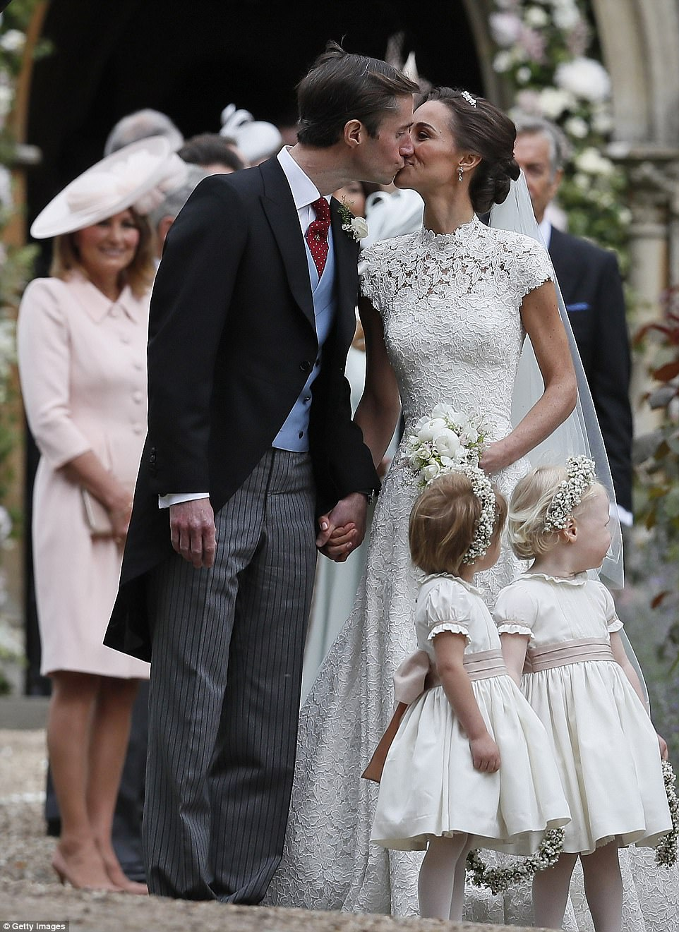 Pippa Middleton and James Matthews kiss after wedding ceremony