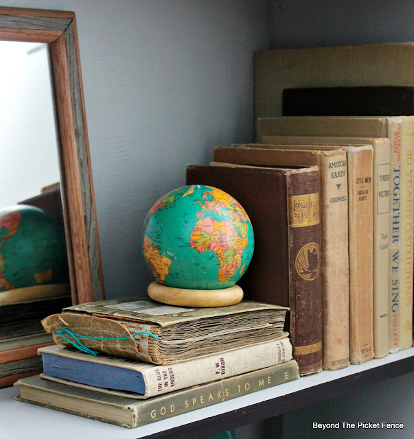 antique books add interest to a bookshelf
