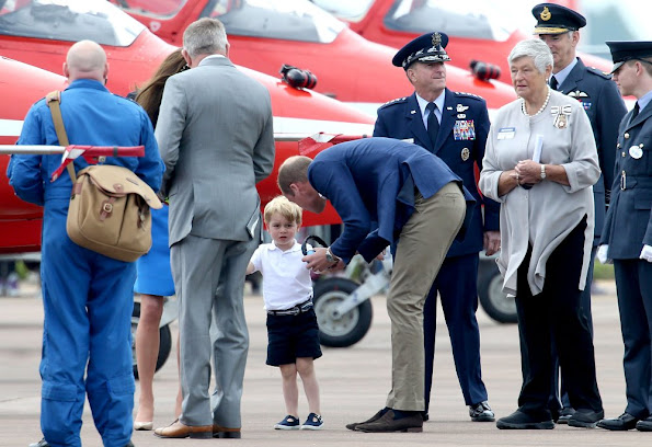 Prince William, Kate Middleton and Prince George visit the Royal International Air Tattoo at RAF Fairford. Kate wore Stella McCartney dress