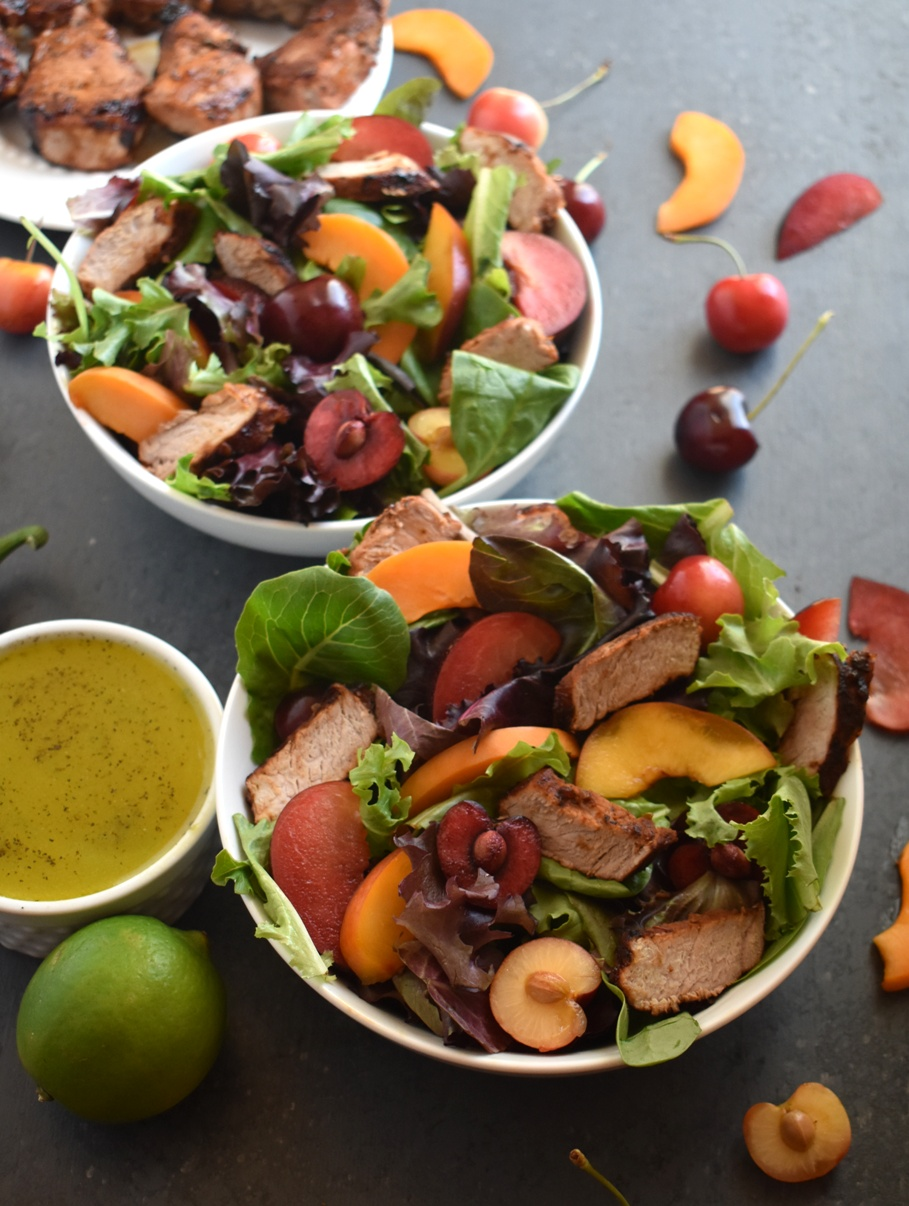 Grilled Pork Tenderloin and Stone Fruit Salad features marinated, flavorful grilled pork, peaches, cherries, plums, apricots and a jalapeno honey lime vinaigrette. www.nutritionistreviews.com