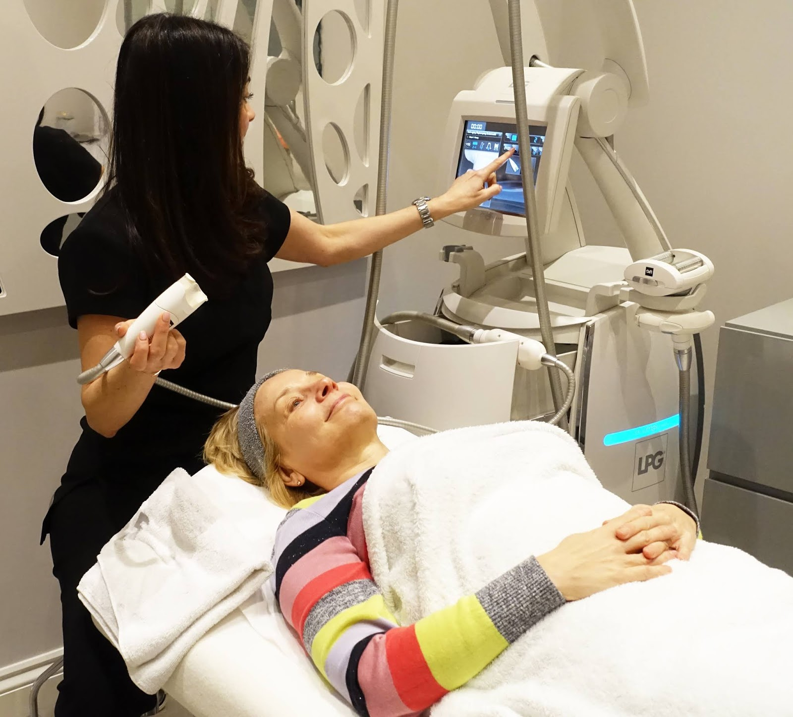 Putting the machine to work:  beauty therapist Sue Ali with her LPG Endermolift facial