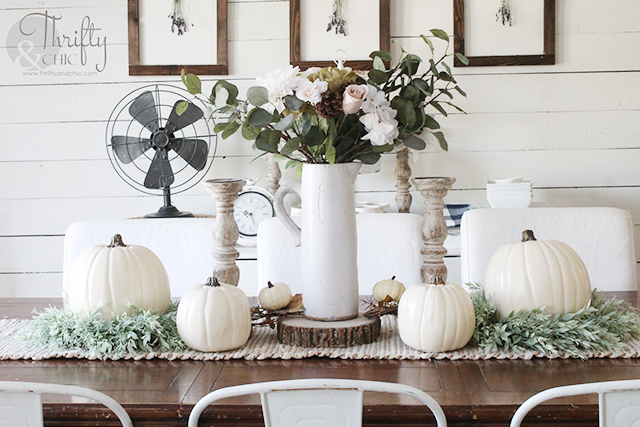 Farmhouse fall decor and decorating ideas. Pastel fall decor. How to decorate for fall. Neutral fall decorating ideas. Fall tablescape ideas. Fall dining room decor and decorating ideas. Farmhouse fall dining room. White and brown dining room. Buffalo check pillows
